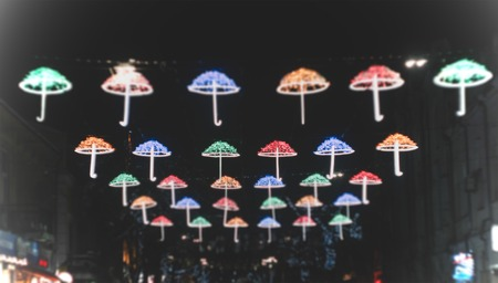 Street umbrella with different colors at the night 写真素材