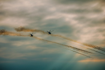 Military helicopter fired anti-armor missiles at the sunset
