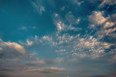 cloudscape with white altocumulus clouds at evening