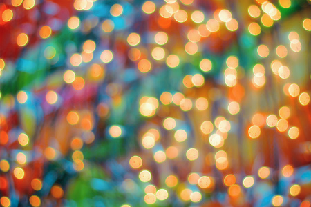 Blurry garland with little lights. Orange toning. Christmas coming concept. 写真素材