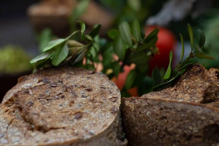 Wheat bread. Buckwheat bread with tomatoes at bush background