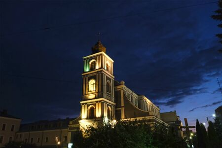 Night city church on light background. Old town. Scenic cityscape. Outdoor tourism landscape. 写真素材