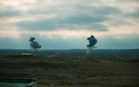 Two air force jets bombing targets at the military trainings