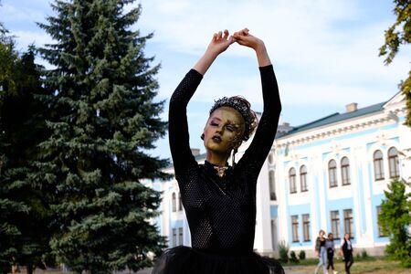 Fashion art Golden skin Woman face portrait at building background