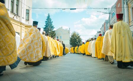 Religious procession, Priests in golden robes walk along the central street at Zhytomyr, Ukraine