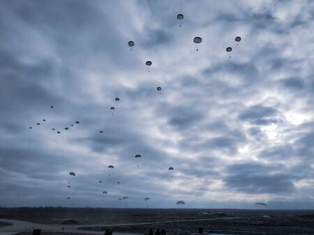 Military Army paratroopers jumping at air war action Stock Photo