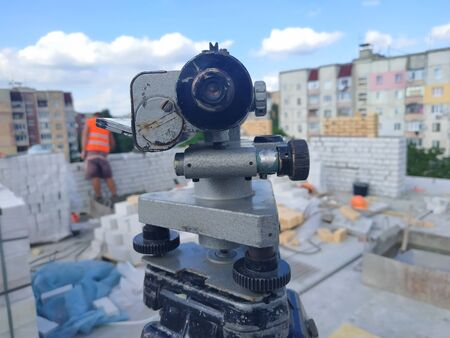 equipment theodolite tool at construction site works in summer Stock Photo