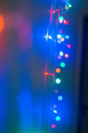 christmas garland blurred lights background with red and blue colors