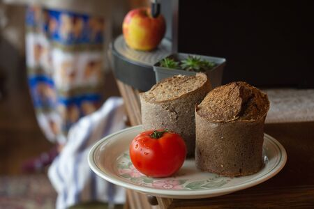 Wheat bread. Buckwheat bread with tomatoes on plate background Stock Photo