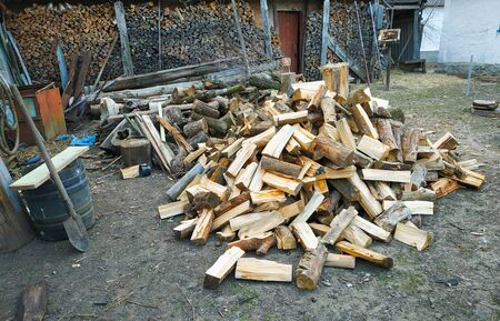 Large bundle of firewood background in the village