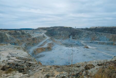 a huge mining career with working excavators, dump trucks and other quarry equipment