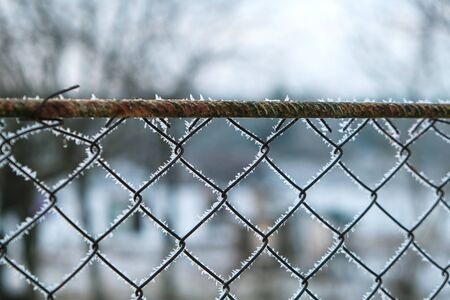 A fence which has become rusted through years of neglect