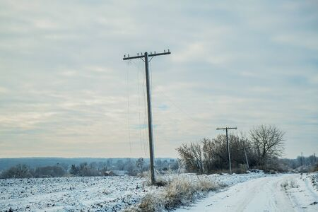 Remote communities. Power electric pole survived after the storm. High voltage survived during hurricane Imagens