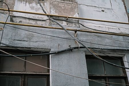 large number of ropes suspended disorderly on building
