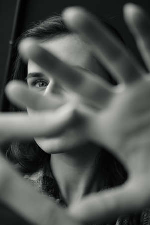 the Girl closes her hand from the camera, black white photo.