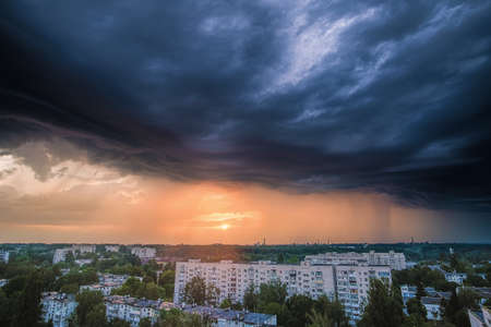 Stormy clouds above the Zhytomyr city, Ukraine. Intense sky from a rainstorm passing through. Vertical view