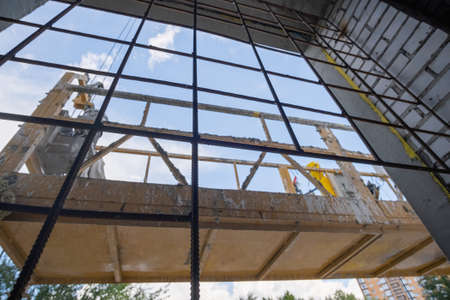 Transport Platforms of scaffold elevator at construction site. Low angle view.