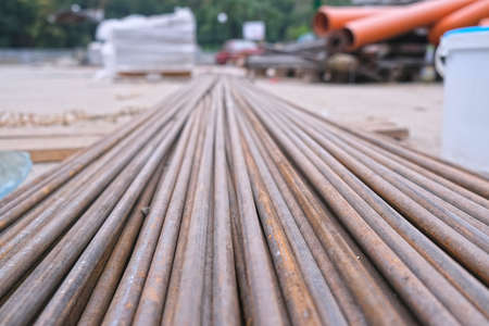 Steel bars for reinforcing concrete. Close up of stack fittings at construction site