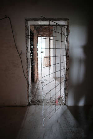 Doorway into an abandoned prison at interior