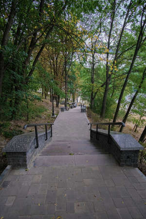 Staircase leading to the river bank. View from public pavilion along the Zhytomyr river, Ukraine. Foto de archivo
