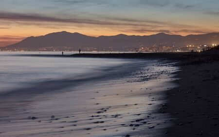 Sunset at Marbella with fishermen