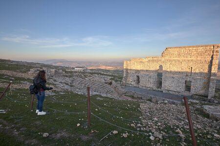 Girl in Acinipo Roman theatre ruins in ronda, old town in the old Ronda village