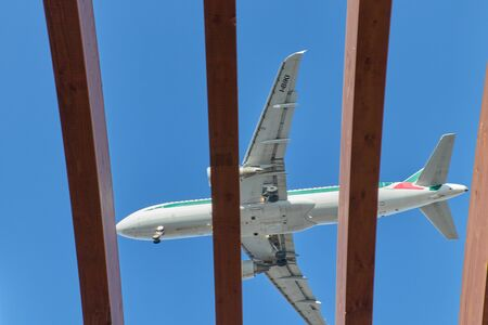 airplane in blue sky close up in Malaga