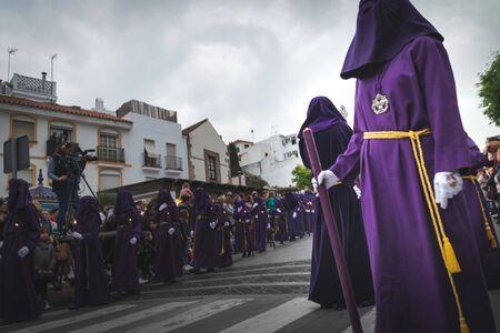 Procession of Holy Week (Semana Santa) in Marbella, Malaga in Spain. Closeup of Nazarene