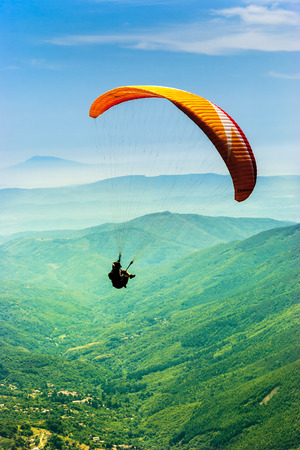 parachute jump: Paragliding in the valley Stock Photo