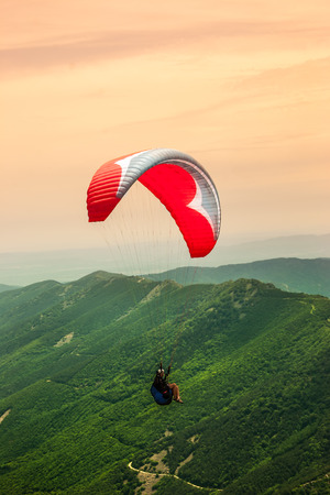Paragliding solo Stock Photo