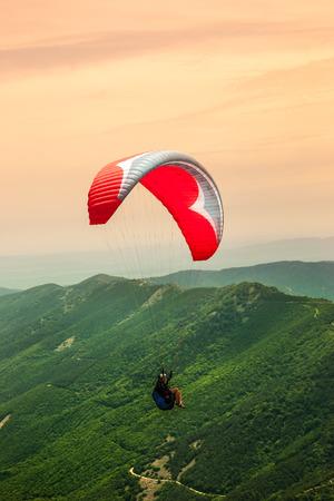 high flier: Paragliding solo Stock Photo