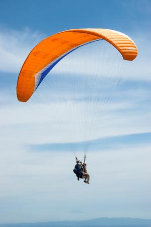 high flier: Tandem paragliding Stock Photo
