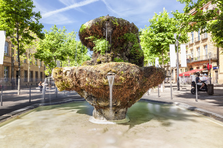 en: Fountain of new guns on the Cours Mirabeau in Aix en Provence France Stock Photo
