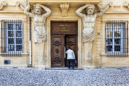 enters: Man enters the commercial court in Aix en Provence France Editorial