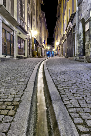 Vertical panorama in the streets of Brianon with streams, France