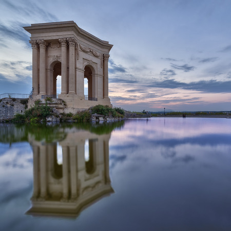 Peyrou Pavilion in Montpellier with reflection and sunset colors, France Stock Photo