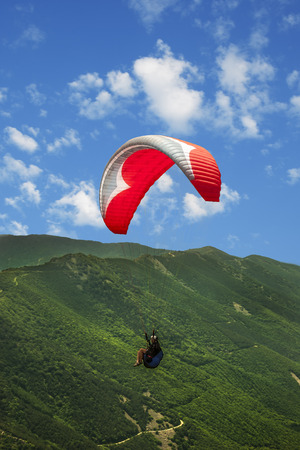 Paragliding solo under clouds