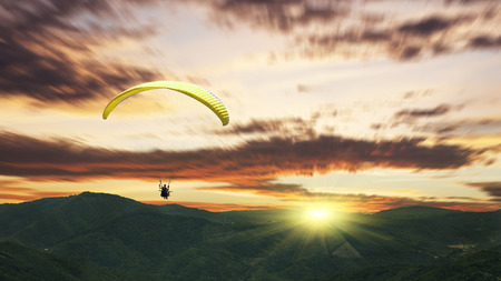 high flier: Paragliding at sunset with purple clouds