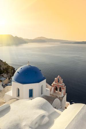 Reflecting sun on a blue dome in Oia, Santorini