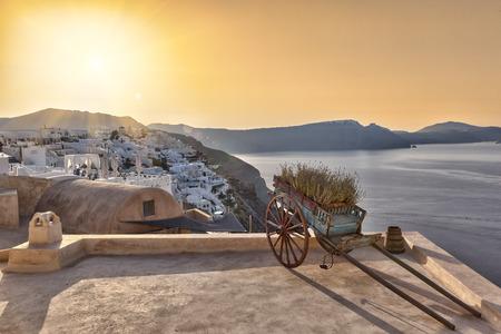 Cart on a roof terrace in Oia at sunrise, Santorini Stock Photo