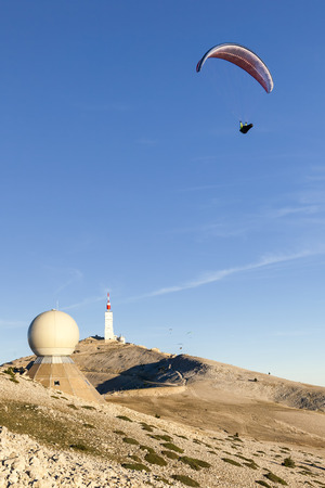 Paraglider moving away from the top of Mont Ventoux Stock Photo