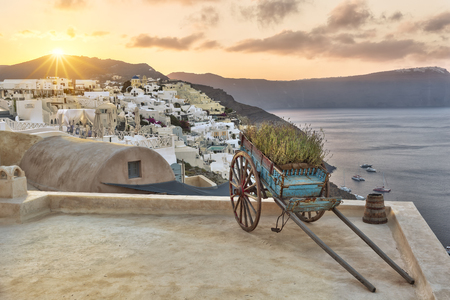 Cart on a roof terrace in Oia at rising sun, Santorini Stock Photo
