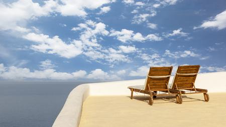 Two sunbathing on a roof terrace in Santorini