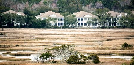 A row of houses across a salt-marsh in the low country of South Carolina.