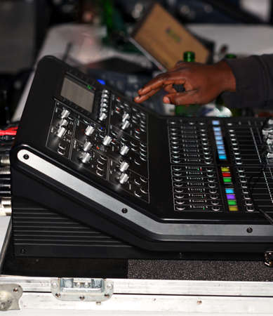 A digital mixing console on a live performance.