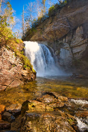 A low angle view of looking glass falls in the Pisgah National Forest in North Carolina near Brevard. Stock Photo