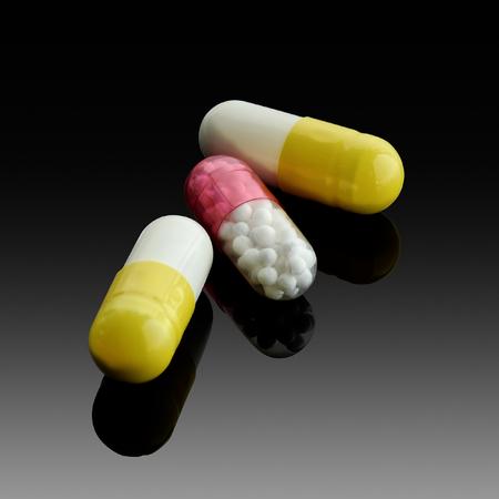 Medication placed in a gelatin capsule on darken background.