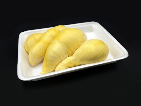 Fresh Durian Fruit on foam tray and black background