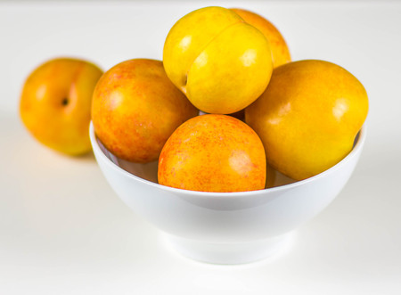 fruit and veg: Yellow plums isolated on white background Stock Photo