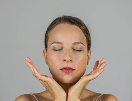 yoga pillows: Beautiful young girl in meditation Stock Photo